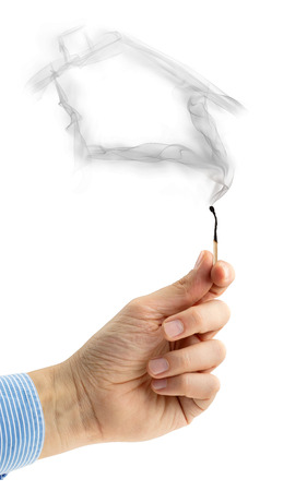 extinguished matchstick with a wisp of smoke house-shaped photo