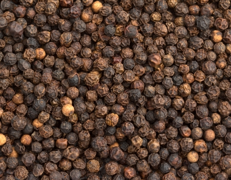 close up of a background of black pepper photo