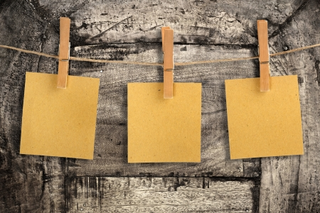 peg board: three cards of recycled paper hanging on a string
