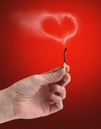 burnt wood: extinguished matchstick with a wisp of smoke heart-shaped