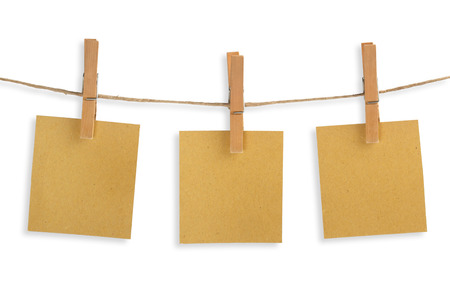 commercial recycling: three cards of recycled paper hanging on a clothesline