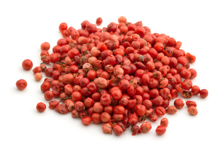 hot pink: heap of red pepper isolated on white background Stock Photo
