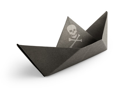 pirate ship made of paper on white background photo
