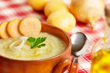close up of a potato soup in a bowl photo
