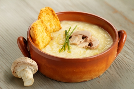 mushroom soup: champignon mushroom soup with chives and croutons