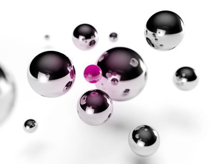 surrounding: steel balls surrounding a small pink sphere Stock Photo