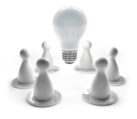 light bulb and white pawns in work meeting photo