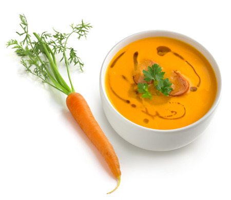 butternut squash: bowl of soup and carrot on white background