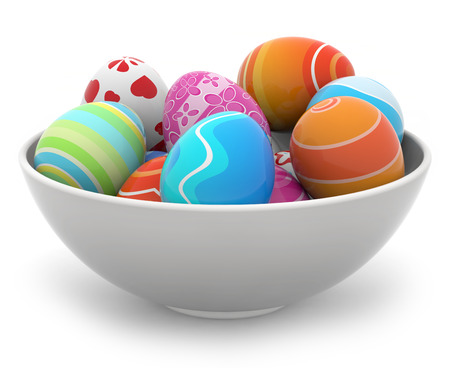 heap of colored Easter eggs in a white bowl photo