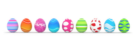 colorful easter eggs in row on white