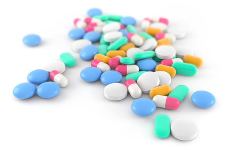 drugs pills: pills and capsules scattered on white background