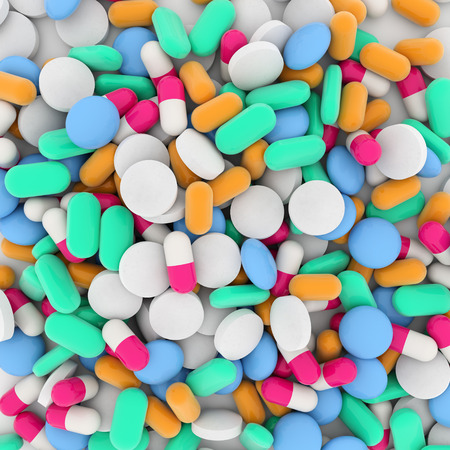background of a pile of colored drugs