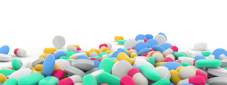 assortment of colorful pills on white background photo