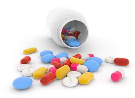 placebo: bottle and mixed drugs scattered on white background Stock Photo
