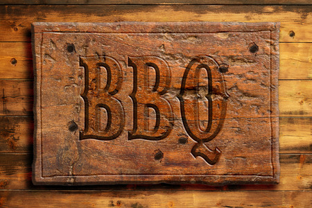 bbq panel on an old wooden wall photo