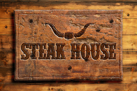 steakhouse panel on aged wooden wall photo