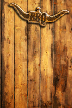 bbq: barbecue insignia with horns on a wooden wall Stock Photo