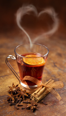 spiced:  glass of mulled wine, cinnamon sticks and star anise Stock Photo