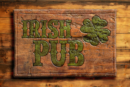 alehouse: Irish pub sign on a wooden wall Stock Photo