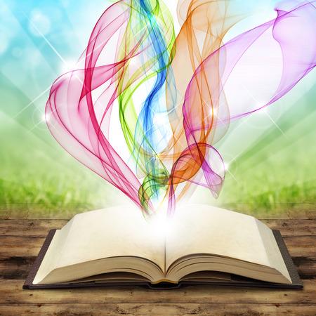 met gekleurde rook wervelingen en krullen open boek