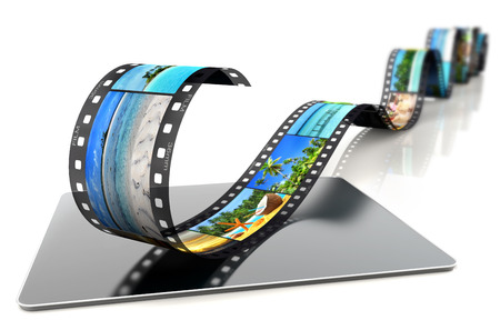 film strip with tropical images on a laptop photo