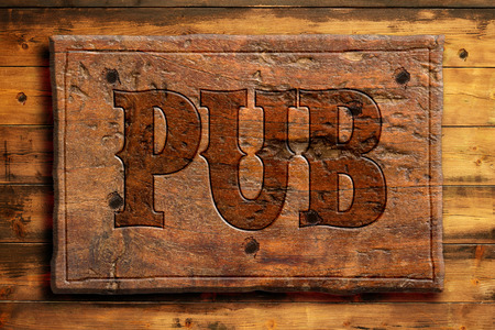 rustic pub sign on wooden wall photo