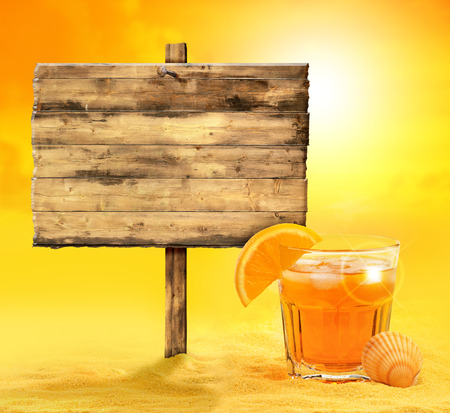 wooden signboard and cocktail on the sand Stock Photo