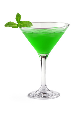 green cocktail in a martini glass on white  photo