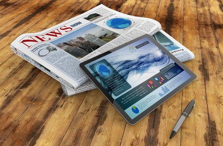 financial newspaper: daily newspaper, tablet and pen on wooden desk
