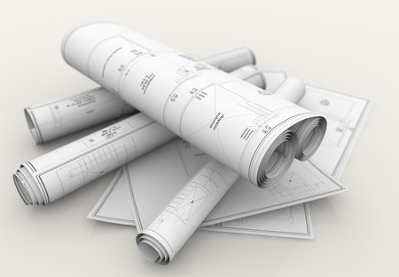 autocad: rolls of technical blueprints on white background