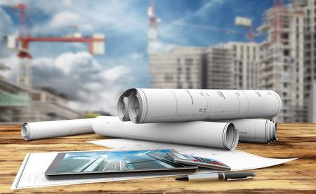 Blaupausen, Tablette, Taschenrechner und Stift in einer Baustelle