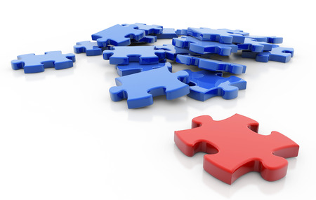 red puzzle piece opposite to a group of blue pieces photo