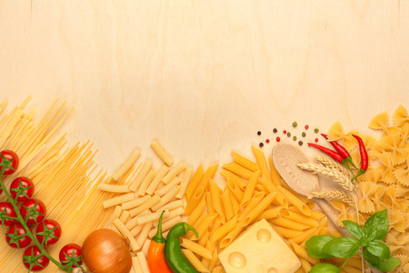 assortment of pasta, emmental and fresh vegetables photo