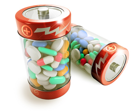 two batteries full of colorful pills on white background photo