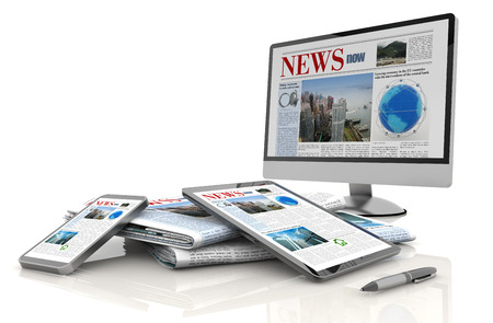 pc monitor, tablet, cellular and daily newspaper photo