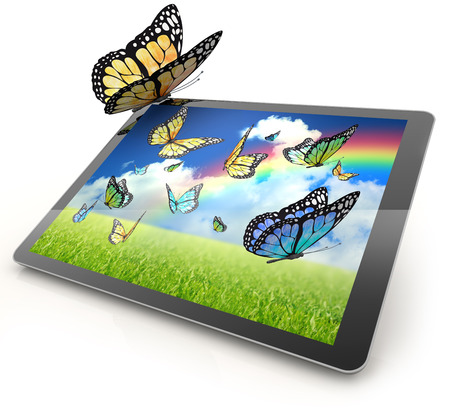 Monarch butterfly resting on a tablet computer photo