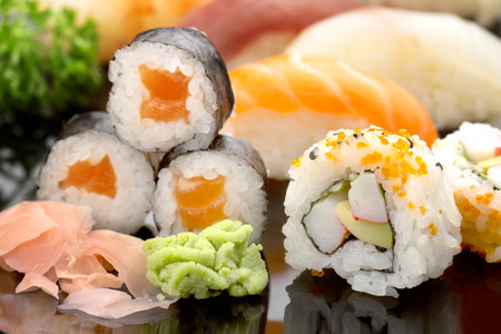 roll bar: close up of japanese sushi on black glass dish