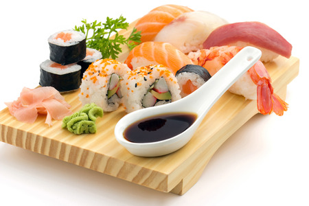 japanese seafood sushi and maki on wooden plate  photo
