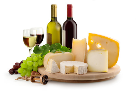 goat cheese: cheeseboard, grapes, wineglasses and wine bottles Stock Photo