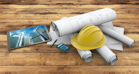 blueprints, protection helmet and tablet on wooden background