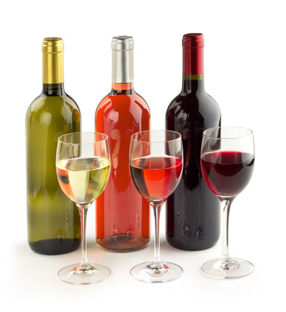 set of wine bottles and wineglasses on white background photo