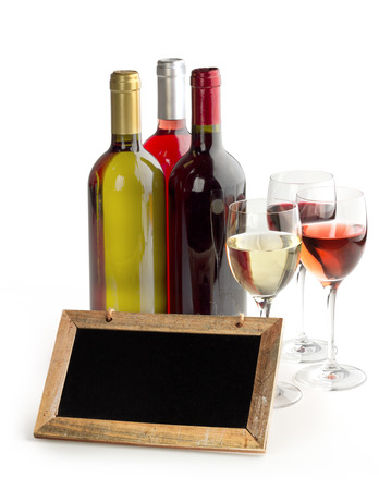 wine bottles, glasses and blackboard on white background photo