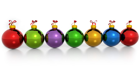 row of colored christmas balls on white background photo