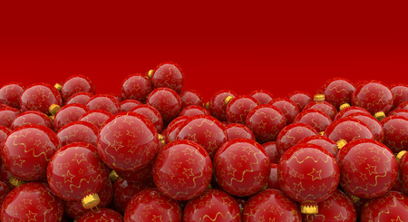 heap of christmas baubles on red background photo