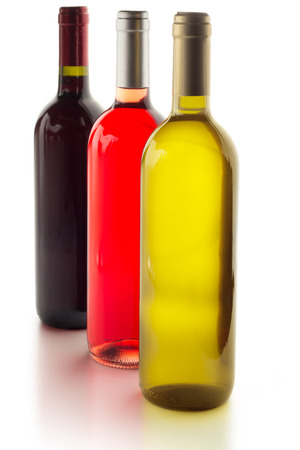 three wine bottles isolated on white background photo