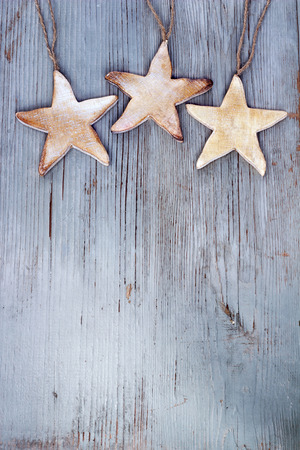 three stars hanging over a weathered wooden board