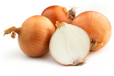 group of brown onions on white background