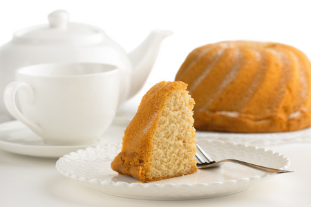 cake, cup of tea and teapot on white background Stockfoto