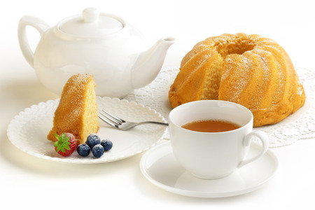 coconut sugar: homemade cake, cup of tea and teapot Stock Photo