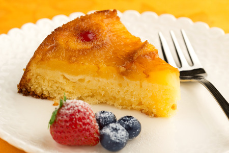baked goods: slice of pineapple cake garnished with berries